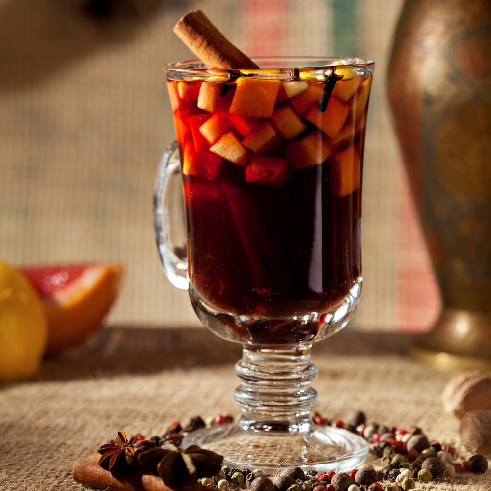 Hot Wine, with a mix of a chopped apple, pineapple and mulling spices like Clove and Cinnamon.